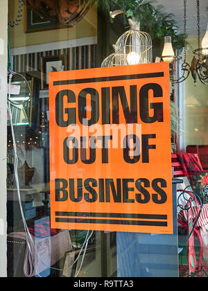 Going Out of Business sign in the window of a small store  or storefront in the small town of Warm Springs, Georgia, USA. - Stock Image
