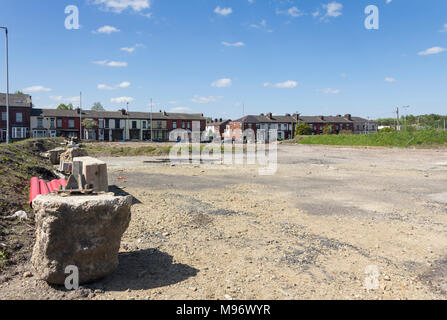 Brownfield site in Bolton, looking towards terraced houses on Manchester Road. Formerly the site of Raikes Park Bolton greyhound stadium. - Stock Image