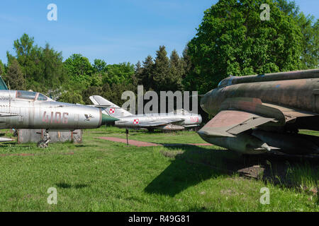 Poland cold war, view of Warsaw Pact era jet fighter aircraft displayed in a field in the Poznan Museum of Armaments, Poland. - Stock Image
