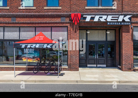 JOHNSON CITY, TN, USA-4/27/19: The Trek Bicycle Store, on W. Market Street in downtown, with a red awning shading bikes on the sidewalk. - Stock Image