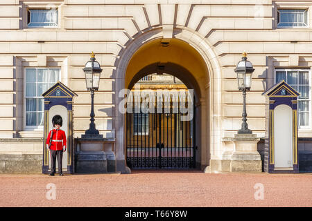 London, UK - October 3, 2018 - A Grenadier Guard on duty and two sentry boxes outside Buckingham Palace - Stock Image