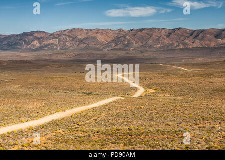Gravel road in the Karoo region of South Africa. - Stock Image
