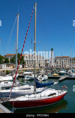 Lighthouse and marina in the Vieux Port of La Rochelle on the coast of the Poitou-Charentes region of France. - Stock Image