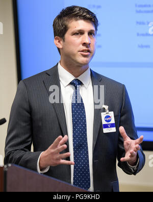 James Uthmeier, of the Department of Commerce, speaks about deregulation and space traffic management initiatives at the first meeting of the National Space Council Users' Advisory Group, Tuesday, June 19, 2018 at NASA Headquarters in Washington. The Users' Advisory Group will advise and inform the National Space Council on a broad range of aerospace topics, including the impacts of U.S. and international laws and regulations, national security space priorities, scientific and human space exploration priorities, and ways to bolster support. - Stock Image