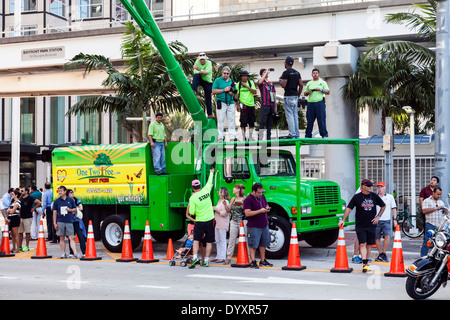 Photographers and cameramen photographing start of 2014 Mercedes-Benz Corporate Run from bucket truck in Miami, Florida, USA. - Stock Image