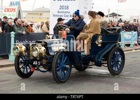 Mr Henry Lawson, driving his  1903 M.M.C. across the finishing line of the 2018 London to Brighton Veteran Car Run - Stock Image