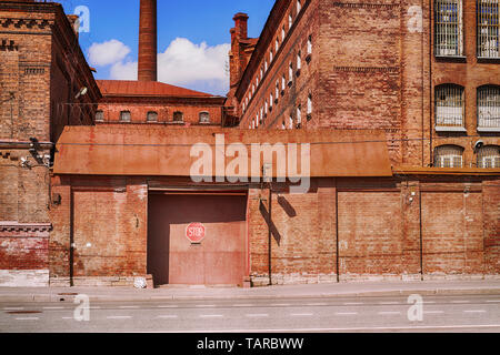 Old brick prison closed gates. Old building of 'Kresty' (Crosses) detention center in Saint Petersburg, Russia. - Stock Image