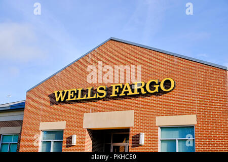 Wells Fargo Bank front exterior entrance showing the corporate logo and sign in Montgomery Alabama, USA. - Stock Image