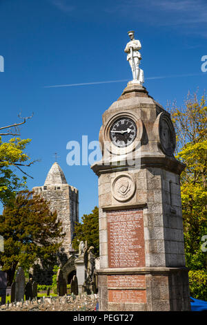 UK, Wales, Anglesey, Llanfechell, War Memorial clock tower by St Mechell's church with unusual tower - Stock Image