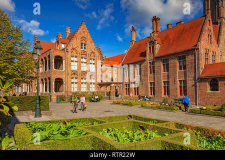 25 September 2018: Bruges, Belgium - People strolling in the courtyard of the medieval St John's Hospital in Bruges, Belgium, on a glorious autumn day - Stock Image