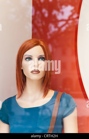 Portrait of a female dummy in window display. - Stock Image