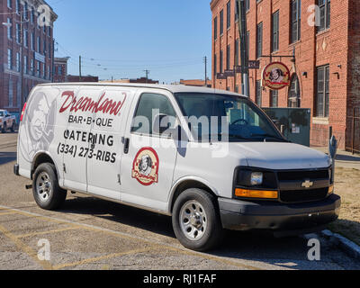 Dreamland BBQ or barbecue catering delivery truck parked with the business sign in background in Montgomery Alabama, USA. - Stock Image