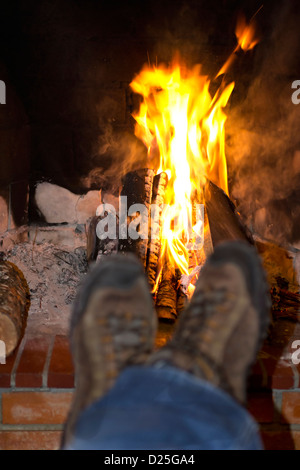 Resting by a confortable fireplace. - Stock Image