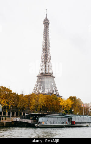 PARIS, FRANCE - NOVEMBER 11, 2018 - Tour Eiffel in a rainy day during the Seine's navigation in bateau mouche - Stock Image