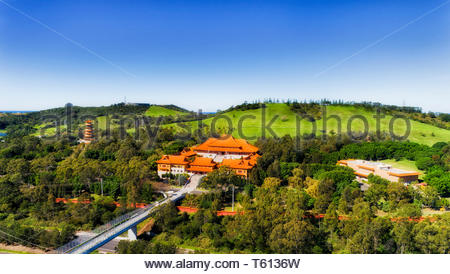 Monastery complex of Nan Tien temple with traditional chinese style architecture building and high pagoda tower - Buddhist religion under blue sky of  - Stock Image