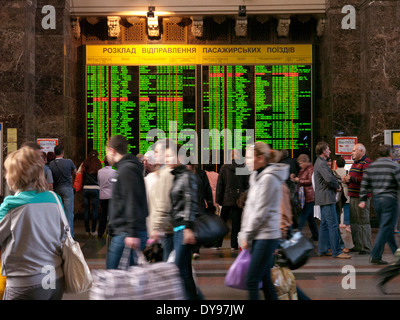 Train arrivals and departures board in the central train station Kiev Ukraine - Stock Image