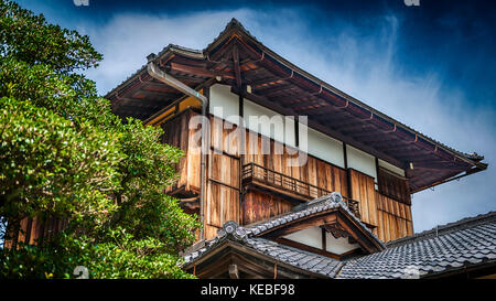 A traditional style Japanese wooden building with a tile roof - Stock Image