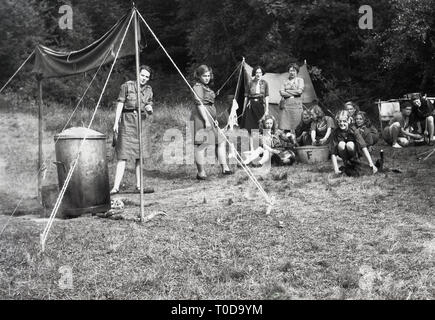 1930s, girl guides at camp. - Stock Image