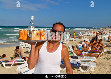 Barkeeper with coconuts and rum at Playa del Este, Santa Maria Del Mar, near Havanna Cuba - Stock Image