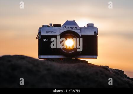 Sunset through Canon FTB lens, camera on a rock - Stock Image