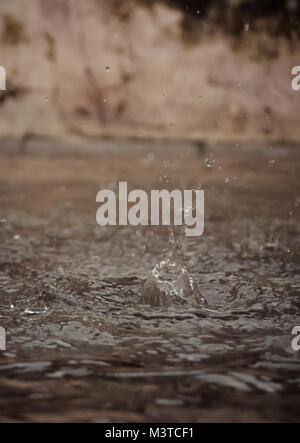 splash water in the pool rainy day - Stock Image