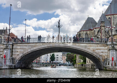The historical buildings and a bridge over Lys river in Ghent, Belgium and Saint Michael´s church. - Stock Image