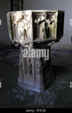 15th century font with carvings of the Apostles, St Nicholas Church, Buckenham, Norfolk - Stock Image