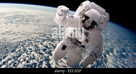 Artist's concept of an astronaut floating in outer space. A cloud covered Earth is below. - Stock Image