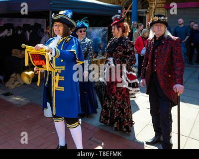 Saltburn by the Sea May 2019 Farmers Market the Town crier with people in Victorian dress announces celebrations for the 150th anniversary of the pier - Stock Image