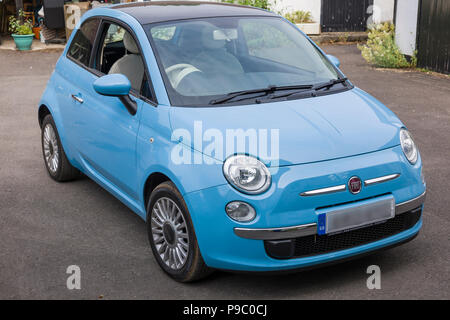 FIAT 500 mini-car circa 2013 in UK with number plate deliberately obscured - Stock Image