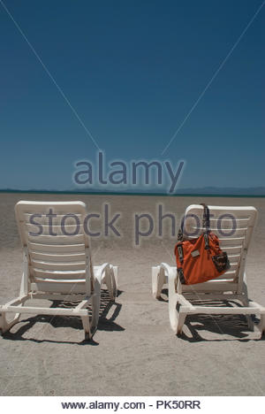 Empty chairs at a beach in Costa Rica - Stock Image