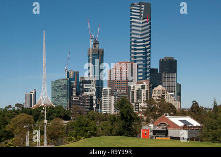 Overlooked by the 297-metre Eureka Tower on Southbank, the CBD is seen from Birrarung Marr park, Melbourne, Australia. ArtPlay building in foreground - Stock Image