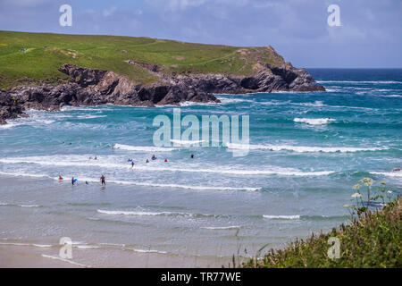 Holidaymakers having fun in the sea at Polly Porth Joke in Newquay in Cornwall. - Stock Image