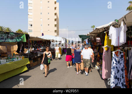 Torre la Mata weekly spanish street market Torrevieja Spain, busy with people buying and selling - Stock Image