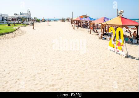 Israel, Tel Aviv - 24 September 2018: Tel Aviv 20 years of pride sign on the beach - Stock Image