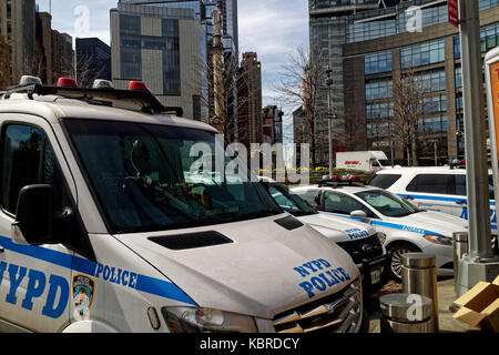 Police cars and trucks parked by Columbus Circle in midtown Manhattan. - Stock Image