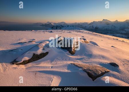 Winter dawn over mountain landscape from summit of Ryten, Moskenesøy, Lofoten Islands, Norway - Stock Image