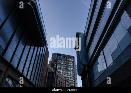 Airplane flying over the city of Leeds - Stock Image