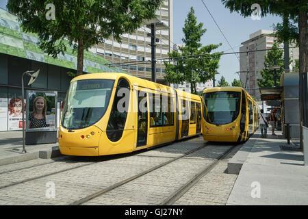 Alstom Citadis 302 trams at Porte Jeune Junction, Mulhouse, Alsace, France -1 - Stock Image