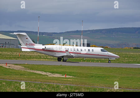 Bombardier Learjet 45 preparing for take off from Inverness Dalcross Airport in the Scottish Highlands .UK - Stock Image