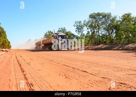 Road Train driving on the remote Peninsula Development Road (PDR), Cape York Peninsula, Far North Queensland, FNQ, QLD, Australia - Stock Image