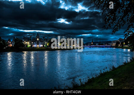 Illuminated Buildings In The Scenic Streets Of The City Of Inverness At The River Ness At Night in Scotland - Stock Image