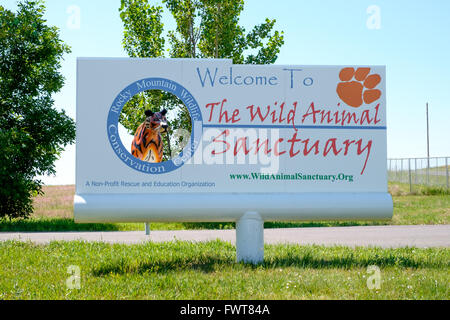 A sign greets visitors at the entrance of The Wild Animal Sanctuary and Rocky Mountain Wildlife Conservation Center - Stock Image