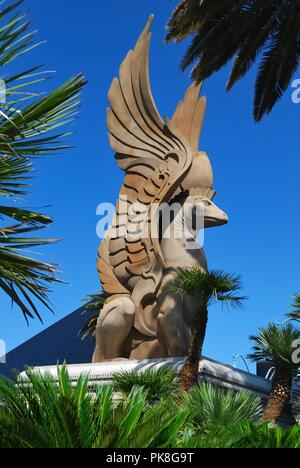 Statue of mythical winged Griffin outside the entrance to the Mandalay Bay Hotel, Las Vegas, Nevada, USA - Stock Image
