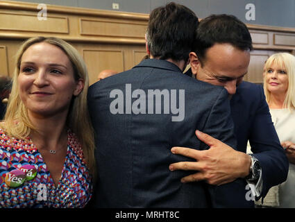An Taoiseach Leo Varadkar (right) and Minister for Health Simon Harris embrace at Dublin Castle as the official results of the referendum on the 8th Amendment of the Irish Constitution are announced in favour of the yes vote. Picture date: Saturday May 26, 2018. See PA story IRISH Abortion. Photo credit should read: Brian Lawless/PA Wire - Stock Image