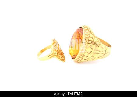 Gold ring on isolated white background - Stock Image