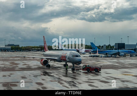 A Jet 2 Boeing 737 waits at the landing gate for boarding passengers - Stock Image