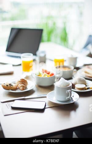 Breakfast on table in cafe - Stock Image