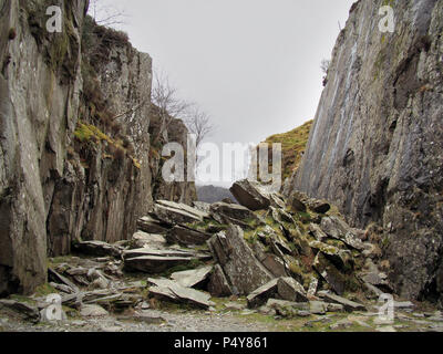 heap of fallen rocks in gulley in Snowdonia National Park, North Wales UK - Stock Image