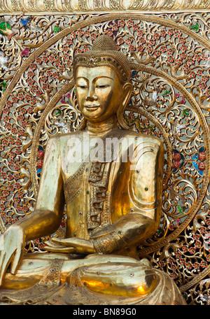Golden Buddhist statue - Stock Image